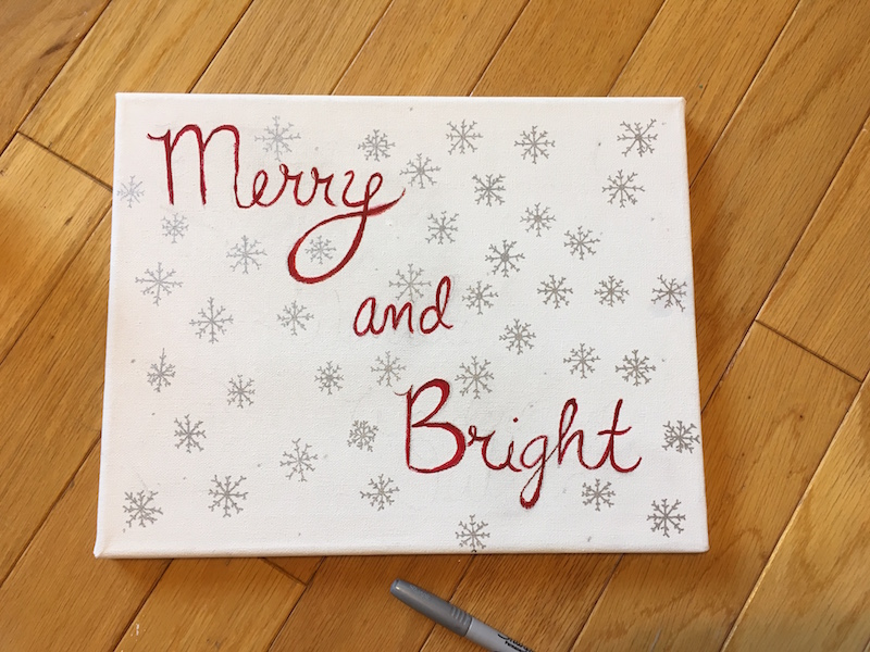 3. Draw snowflakes on the canvas with the silver marker. Make sure the number of snowflakes equals the number of Christmas lights you have, as you will be poking the lights through the center of each snowflake.