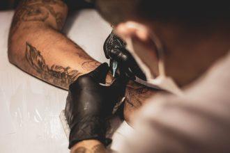 Tattoo Artist Inking an Arm